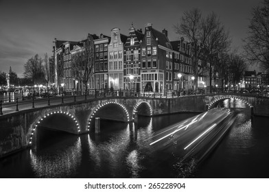 Amsterdam, Netherlands canals and bridges. Night view of Keizersgracht and famous touristic place