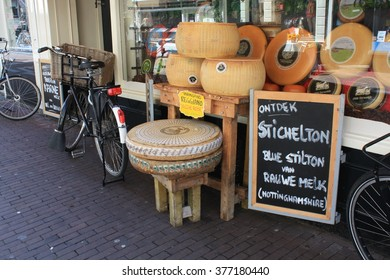 Amsterdam, The Netherlands, circa 09.2010. A cheese store with traditional giant rounds of edam and gouda and a bike.