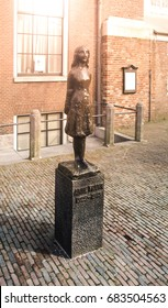 AMSTERDAM, NETHERLANDS - CIRCA APRIL 2009: Anne Frank Monument. Memorial statue of young Jewish girl - victim of holocaust - at Anne Frank's House.