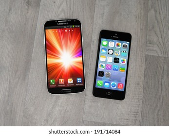 AMSTERDAM, THE NETHERLANDS - CIRCA APRIL 2014 - Samsung Galaxy S smartphone and Apple iPhone.