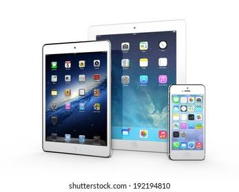 AMSTERDAM, THE NETHERLANDS, CIRCA APRIL 2014 - Three Apple iOS devices on display: iPad 3, iPad Mini and iPhone 5s.