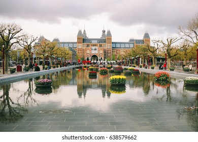 AMSTERDAM. THE NETHERLANDS - CIRCA APRIL 2017: View of the Rijksmuseum and the pond in Museum Square in Amsterdam