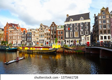 Amsterdam Netherlands dancing houses over river in old european city Amsterdam spring landscape. Holland, Netherlands