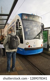 AMSTERDAM, NETHERLANDS - DEC 11, 2018 - Blue tram near the Centraal Railroad Station in Amsterdam, Netherlands