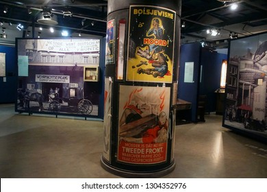 AMSTERDAM, NETHERLANDS - DEC 11, 2018 - German propaganda  poster to recruit Dutch men to a unit of the Waffen SS, World War II Resistance Museum, Amsterdam, Netherlands