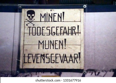 AMSTERDAM, NETHERLANDS - DEC 11, 2018 - Sign warning of danger due to mines in German and Dutch, World War II Resistance Museum, Amsterdam, Netherlands