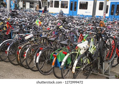 AMSTERDAM, NETHERLANDS - DEC 12, 2018 - Rows of bicycles are common in Amsterdam, Netherlands
