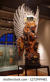 AMSTERDAM, NETHERLANDS - DEC 12, 2018 - Large wooden dragon sculpture from Indonesia, Tropen Museum, Amsterdam, Netherlands