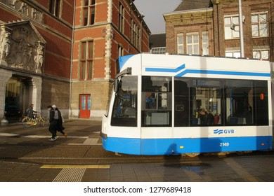 AMSTERDAM, NETHERLANDS - DEC 12, 2018 - Blue tram near the Centraal Railroad Station in Amsterdam, Netherlands
