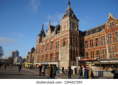 AMSTERDAM, NETHERLANDS - DEC 13, 2018 - Centraal Railroad Station building and tram lines, Amsterdam, Netherlands