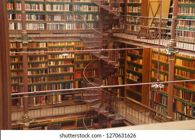 AMSTERDAM, NETHERLANDS - DEC 14, 2018 - Spiral staircase in the library of the Rijks Museum, Amsterdam, Netherlands
