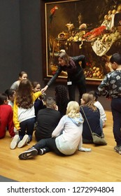 AMSTERDAM, NETHERLANDS - DEC 14, 2018 - School kids study a painting  in the Rijks Museum, Amsterdam, Netherlands