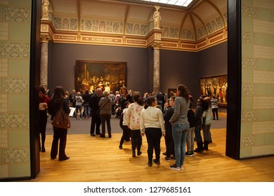 AMSTERDAM, NETHERLANDS - DEC 14, 2018 - Visitors view and photograph Rembrandt's Night Watch  in the Rijks Museum, Amsterdam, Netherlands