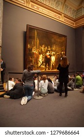 AMSTERDAM, NETHERLANDS - DEC 14, 2018 - School kids visit Rembrandt's Night Watch  in the Rijks Museum, Amsterdam, Netherlands