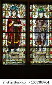 AMSTERDAM, NETHERLANDS - DEC 14, 2018 - Stained glass windows of Rembrandt in the great hall of the Rijks Museum, Amsterdam, Netherlands
