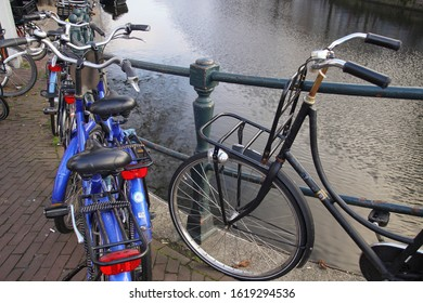 AMSTERDAM, NETHERLANDS - DEC 14, 2018 - Bicycles on a canal in Amsterdam, Netherlands