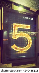 AMSTERDAM, THE NETHERLANDS - DEC 20, 2014: Chanel ad for Chanel No.5 fragrance advertising campaign at the Rembrandt square tram stop. Filtered toned image in instagram look.