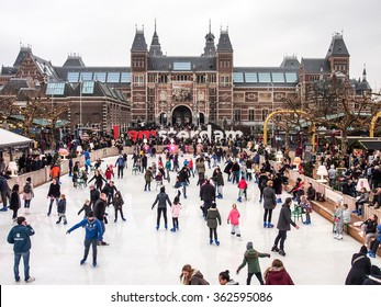 AMSTERDAM, NETHERLANDS - DEC 27, 2015: People enjoy ice skating in front of Rijksmuseum in Amsterdam, Netherlands. The museum is a Netherlands national museum found in 1800.
