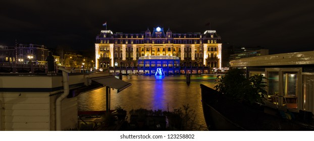 AMSTERDAM, NETHERLANDS - DEC 29: Panorama of the five star Amstel hotel at night during the Amsterdam Light festival in Amsterdam, the Netherlands on December 29, 2012