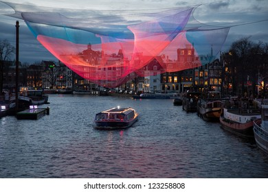 AMSTERDAM, NETHERLANDS - DEC 29: Piece of light art at night during the Amsterdam Light festival in Amsterdam, the Netherlands on December 29, 2012