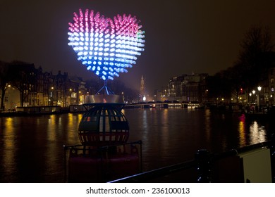 AMSTERDAM, NETHERLANDS - DEC 5: Piece of light art at night during the Amsterdam Light festival in Amsterdam, The Netherlands on December 5, 2014