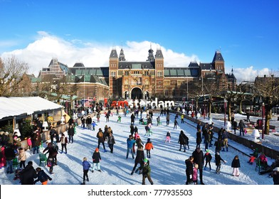 AMSTERDAM, NETHERLANDS, DECEMBER 11, 2017: People ice-skating in front of Rijksmusem and IAMSTERDAM sign during winter in Amsterdam, The Netherlands