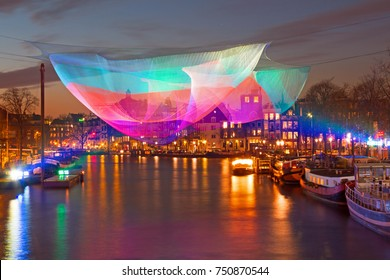 AMSTERDAM, NETHERLANDS - DECEMBER 13, 2012: Amsterdam light festival on the river Amstel in Amsterdam Netherlands at 13th of december 2012
