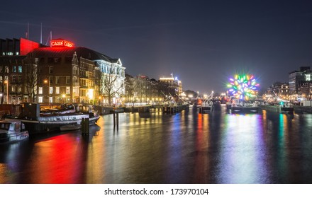 AMSTERDAM, NETHERLANDS - DECEMBER 14: Carre and the skinny bridge at night, during the second edition of the Amsterdam Light Festival on December 14, 2013 in Amsterdam.
