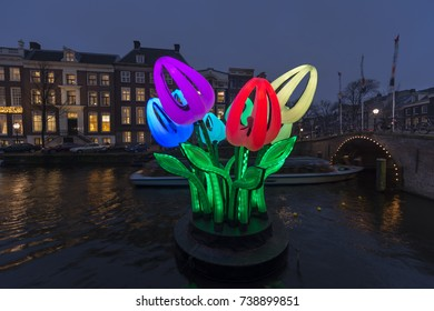 Amsterdam, The Netherlands - December 16, 2016: Amsterdam,canal Herengracht with lights and artwork Bunch of Tulips by Peter Koros during Amsterdam Light Festival in winter.