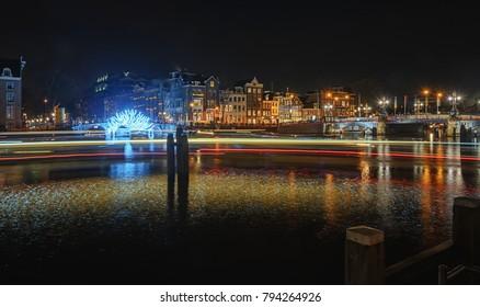 Amsterdam, Netherlands, December 16, 2017:  Tunnel of light under the bridge towards the Herengracht during the Festival of Light in Amsterdam