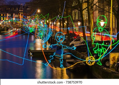 "Amsterdam, The Netherlands - December 17, 2015: Amsterdam canal ""Herengracht"" during the Amsterdam Light Festival with ""Paths crossing"" of Ralf Westerhof, consisting of colorful lines of light."