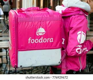 Amsterdam, Netherlands -december 17, 2017: Foodora courier with backpack in Asterdam