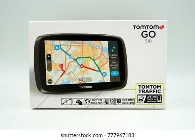 Amsterdam, The Netherlands-  December 17, 2017: TomTom Go GPS Car navigation system retail box against a white background.