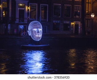 AMSTERDAM, NETHERLANDS - DECEMBER 19, 2015: Light installations on night canals of Amsterdam within light festival on December 19, 2015 in Amsterdam - Netherland.