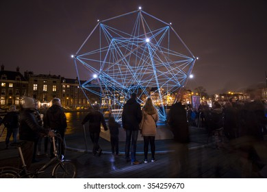 Amsterdam, the Netherlands December 20, 2015 : artwork called The Uniting Lightstar from Venividimultiplex exhibited at Amsterdam Light Festival 2015 which is dedicated to theme 'Friendship'