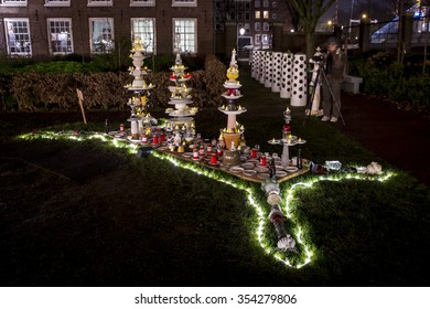 Amsterdam, the Netherlands December 20, 2015 : artwork with fluorescent piles up tables exhibited in the Hermitage garden at Amsterdam Light Festival 2015 which is dedicated to theme 'Friendship'p'