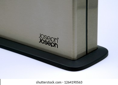 Amsterdam, the Netherlands - December 21, 2018: Close Up of a Joseph Joseph logo on a silver case of a Chopping Board Set against a white background.