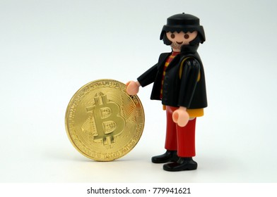 Amsterdam, The Netherlands - December 22, 2017: Playmobile concept of bitcoin (BTC) / cryptocurrency crime and theft by an hacker.
