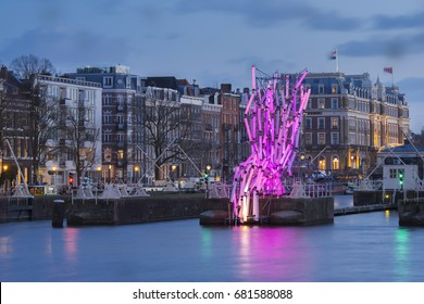 Amsterdam, The Netherlands - December 26, 2016: Amsterdam with river Amstel during the Amsterdam Light Festival, also artwork Nexus.