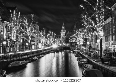 Amsterdam, The Netherlands, December 26, 2017:  Black and white photo of the  Spiegelgracht in the old town of Amsterdam with the Rijks Museum in the background