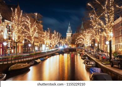 Amsterdam, The Netherlands, December 26, 2017:  The Spiegelgracht in the old town of Amsterdam with the Rijks Museum in the background