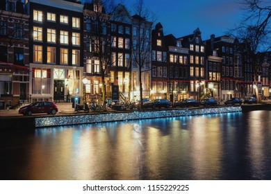 Amsterdam, The Netherlands, December 26, 2017:  Light object named floating on a thousand memories, along the quay wall of the Herengracht during the Light Festival in Amsterdam
