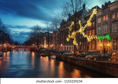 Amsterdam, The Netherlands, December 26, 2017:  Light object above the Herengracht canal during the Light Festival in Amsterdam
