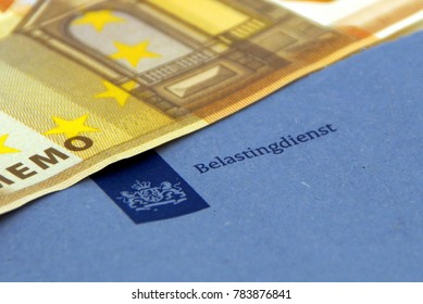 Amsterdam, The Netherlands - December 30, 2017: Blue enveloppe of the dutch tax department ('Belastingdienst') with a 50 Euro note.