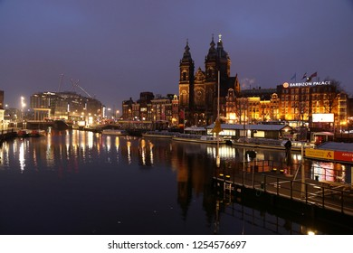 AMSTERDAM, NETHERLANDS - DECEMBER 6, 2018: Early morning canal view in Amsterdam, Netherlands. Amsterdam is the capital city of The Netherlands.