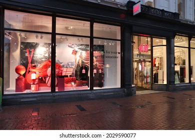 AMSTERDAM, NETHERLANDS - DECEMBER 6, 2018: HM fashion shop in Amsterdam, Netherlands. HM is a Swedish brand known internationally for its casual collection.