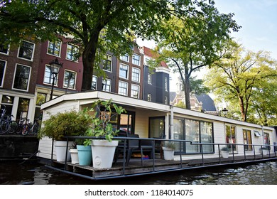 Amsterdam, The Netherlands, Europe, 30-August- 2018. Houseboats and traditional buildings along the canal in Amsterdam.