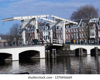 Amsterdam, Netherlands, Europe, November 19th 2017. Photo of the famous Skinny Bridge, or Magere Grug over the River Amstel seen in bright winter sunshine.