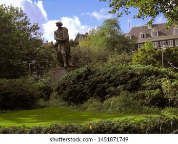 AMSTERDAM, NETHERLANDS, EUROPE - OCTOBER 2004: Statue of the famous painter Rembrandt van Rijn on the in Amsterdam. Vintage aspect of Amsterdam city - old historical archive in Netherlands in 2004
