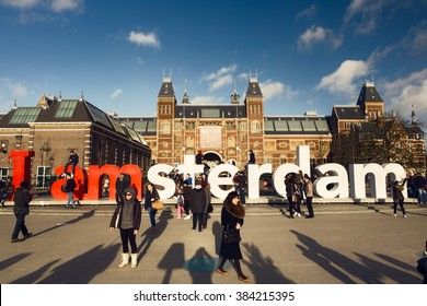 Amsterdam, The Netherlands - February 05, 2016 - People in front of the Rijksmuseum. Statue 'I Amsterdam'.